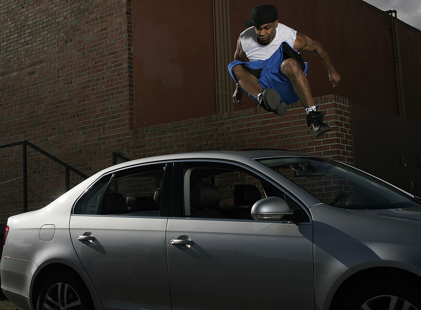 "Demetrius ""Hook"" Mitchell jumps over a car during a Volkswagen event during NBA All Star Weekend February 19, 2005 in Denver, Colorado."