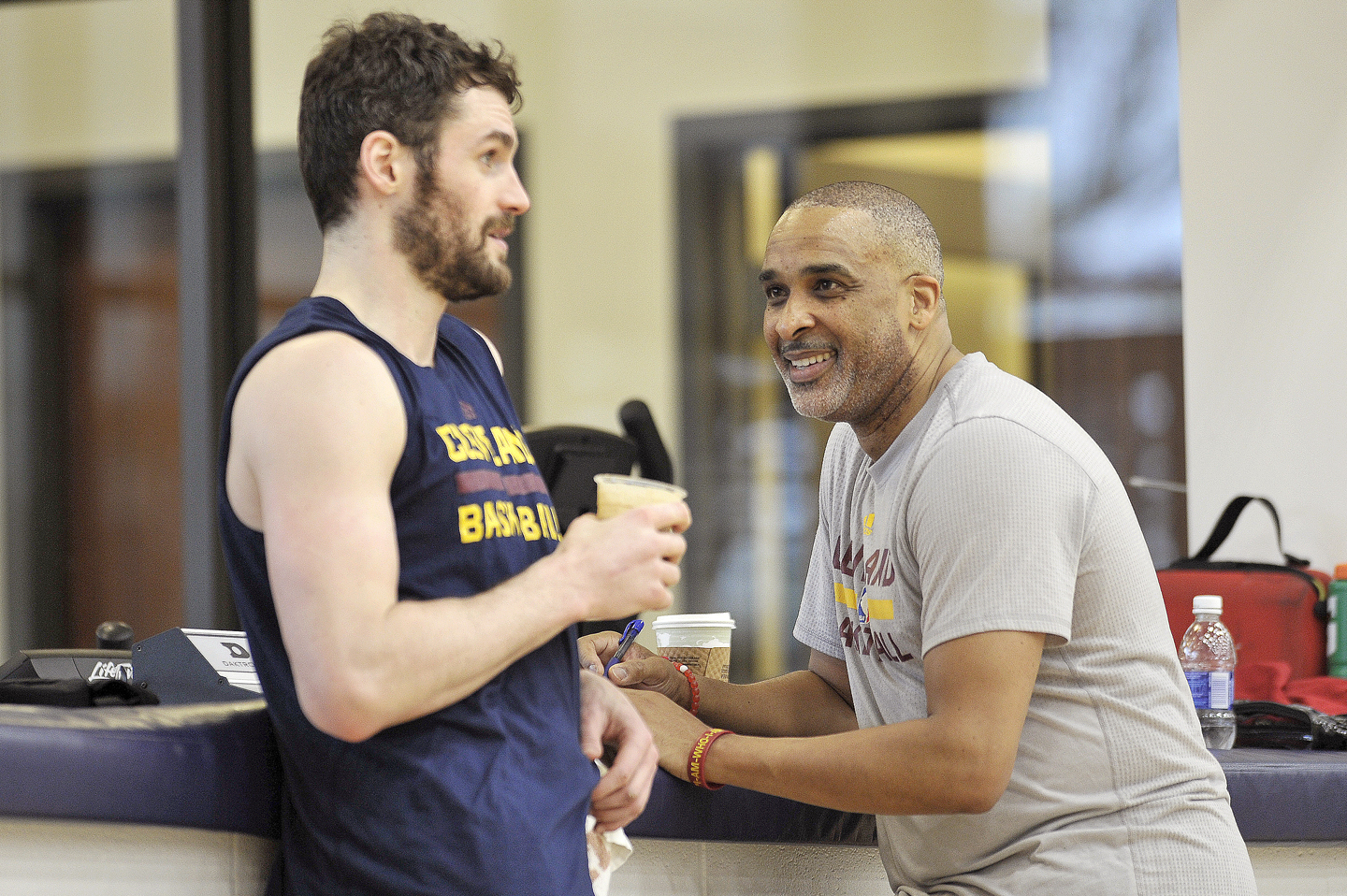 Kevin Love #0 and Phil Handy of the Cleveland Cavaliers talk during an all access practice at The Cleveland Clinic Courts on April 28, 2016 in Independence, Ohio.