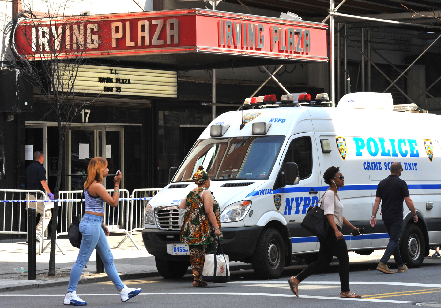 A New York Police Department Crime Scene Unit is seen outside Irving Plaza on May 26, 2016 in New York. One person was killed and three others injured at a prominent New York music venue late May 25, 2016 during a show to be headlined by rapper T.I., police said. Concert-goers at Irving Plaza raced out in panic as shots rang out at 10:15 pm (0200 GMT Thursday) during the opening act before T.I., an Atlanta rapper with a history of legal run-ins.Police said a 33-year-old man was shot in the stomach and pronounced dead at a hospital near Irving Plaza, which is near Manhattan's bustling Union Square and the upscale Gramercy Park district. / AFP / TIMOTHY A. CLARY (Photo credit should read )