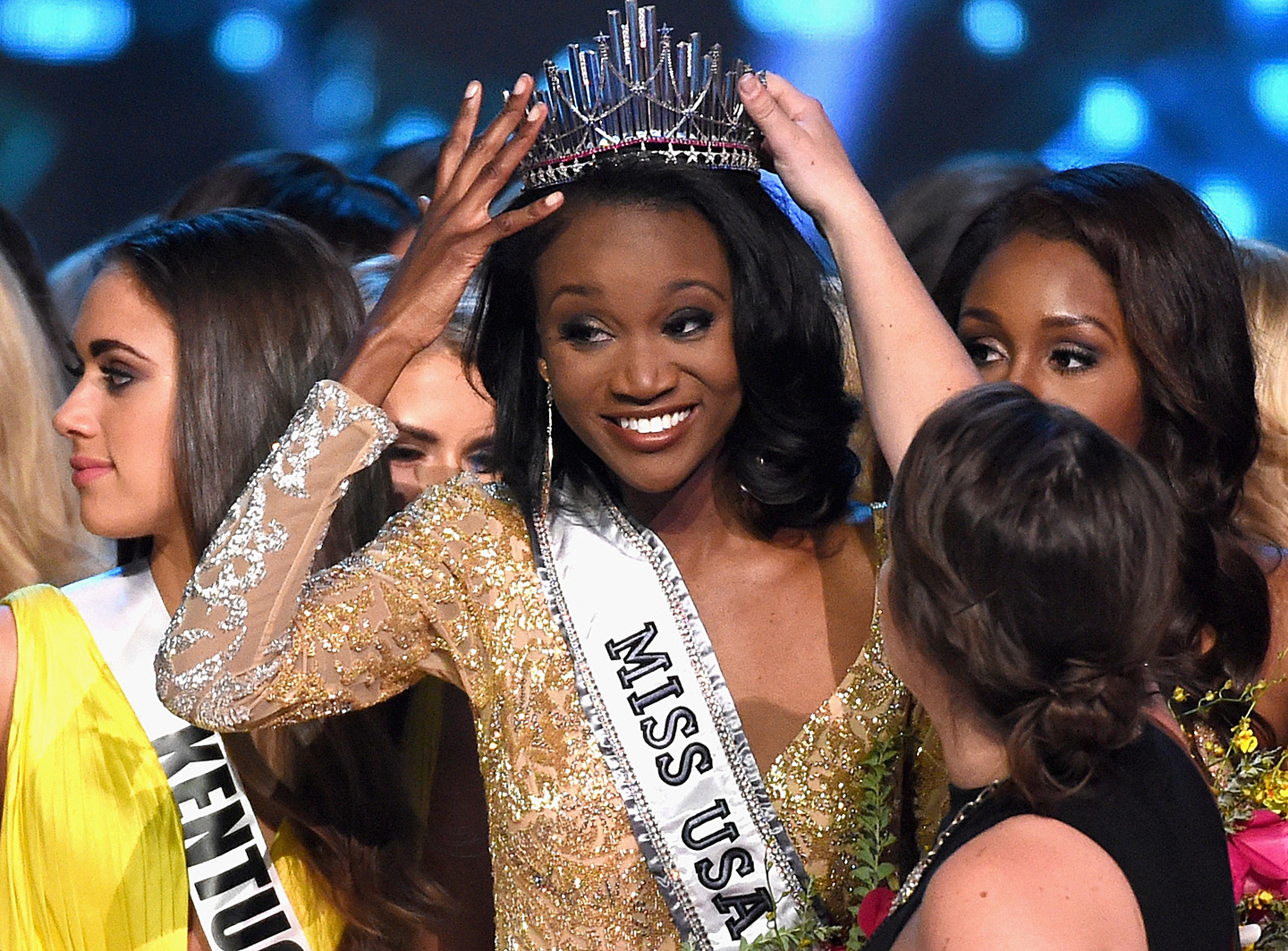 Miss District of Columbia USA 2016 Deshauna Barber (C) reacts with the other contestants after being crowned Miss USA 2016 during the 2016 Miss USA pageant at T-Mobile Arena on June 5, 2016 in Las Vegas, Nevada.