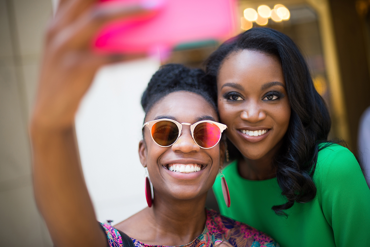 Miss USA 2016 Deshauna Barber (R) poses for a selfie with a fan in Midtown on June 7, 2016 in New York City.