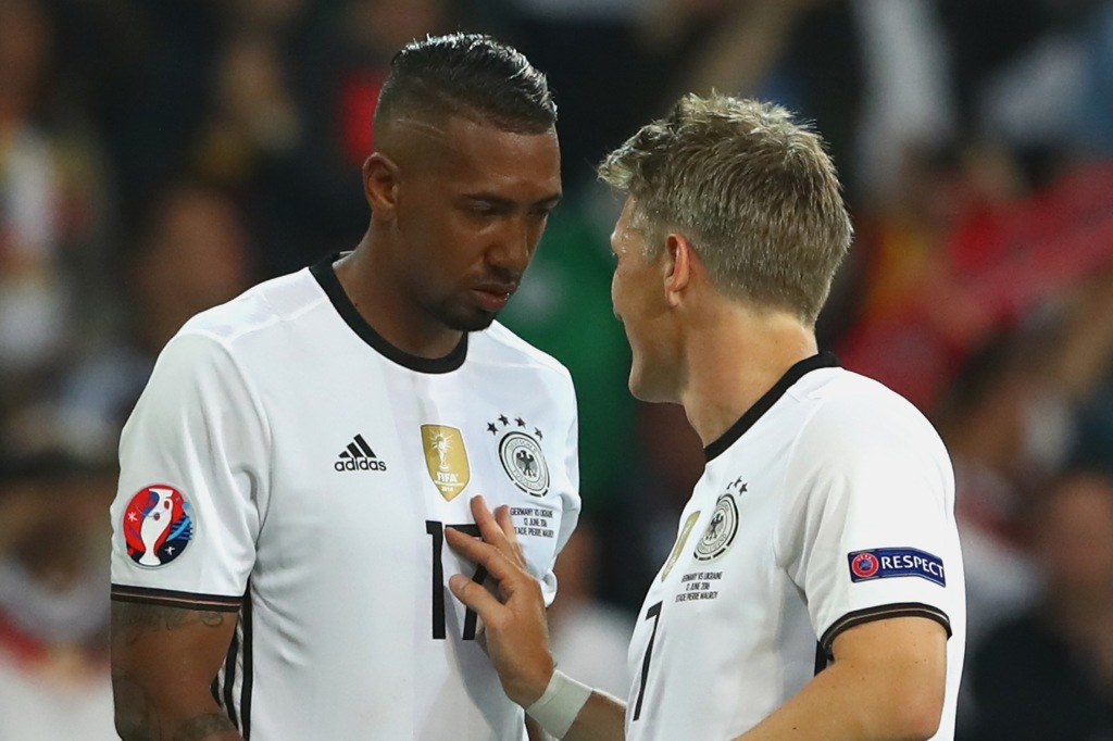 LILLE, FRANCE - JUNE 12: Bastian Schweinsteiger of Germany talks to his team mate Jerome Boateng after the UEFA EURO 2016 Group C match between Germany and Ukraine at Stade Pierre-Mauroy on June 12, 2016 in Lille, France. (Photo by Alexander Hassenstein/Getty Images)