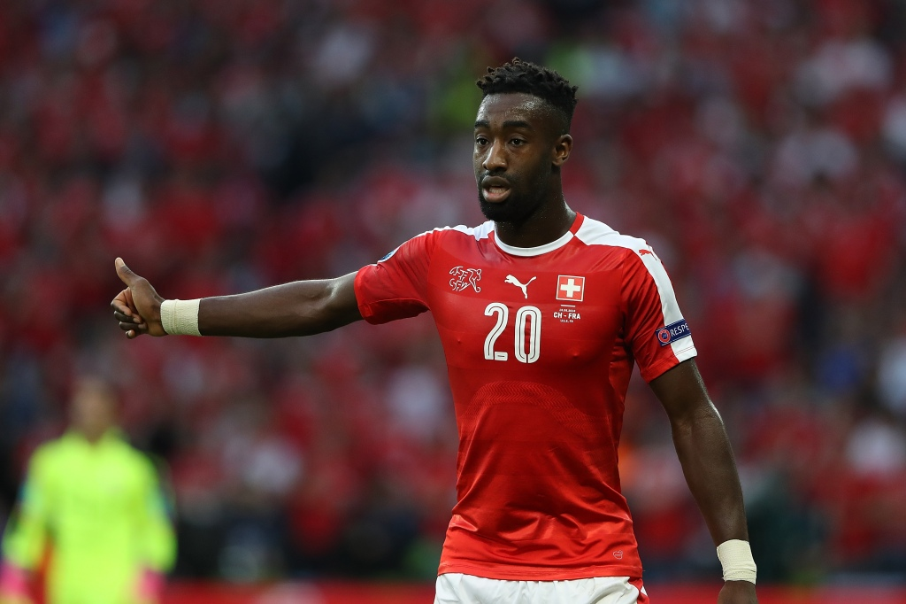 LILLE, FRANCE - JUNE 19: Johan Djourou of Switzerland gestures during the UEFA EURO 2016 Group A match between Switzerland and France at Stade Pierre-Mauroy on June 19, 2016 in Lille, France. (Photo by Matthew Ashton - AMA/Getty Images)