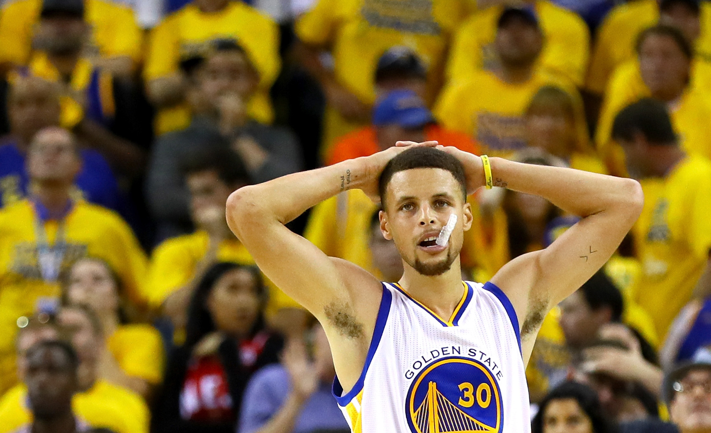 Stephen Curry #30 of the Golden State Warriors reacts after losing 93-89 in Game 7 of the 2016 NBA Finals against the Cleveland Cavaliers at ORACLE Arena on June 19, 2016 in Oakland, California.