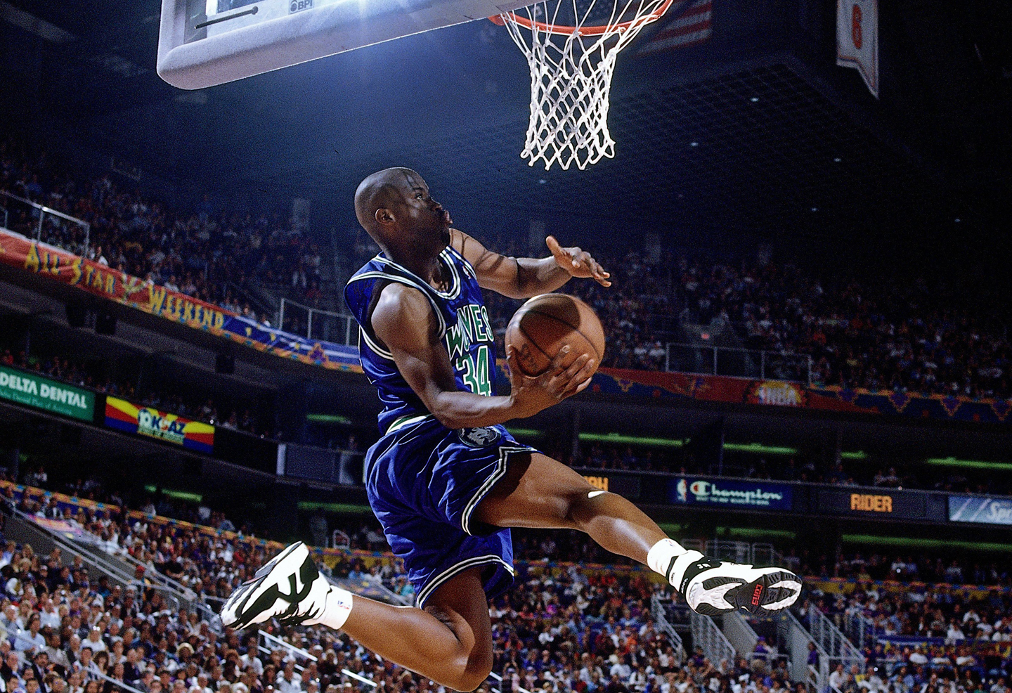 Isaiah Rider #34 of Minnesota Timberwolves attempts a dunk during the 1995 Slam Dunk Contest.