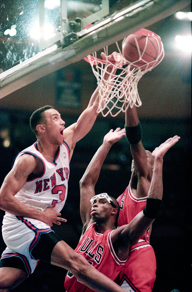 John Starks going up over Bulls # 23 Michael Jordan and Bulls # 24 Horace Grant with a Left handed dunk. The Dunk photo taken at Madison Square Garden. (Photo by Tom Berg/WireImage)