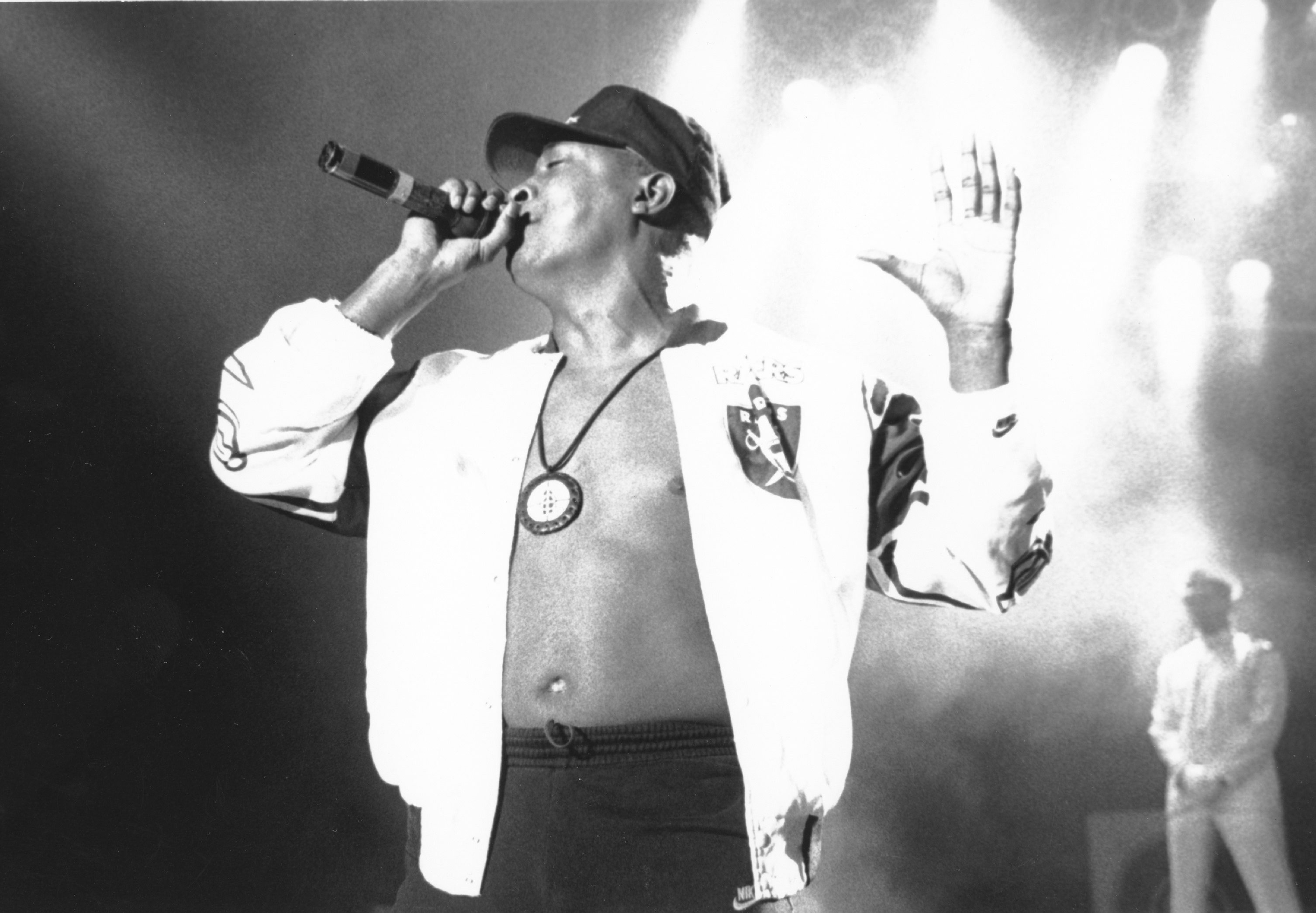 "1990: Rapper Chuck D of the rap group ""Public Enemy"" performs onstage in 1990."
