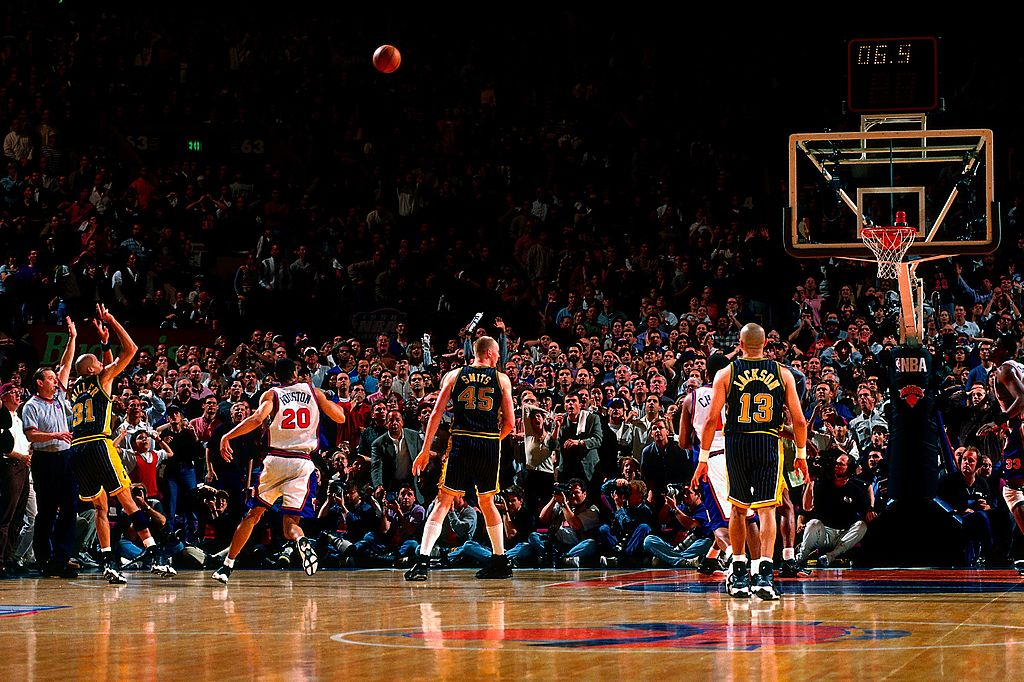 NEW YORK - MAY 10: Reggie Miller #31 of the Indiana Pacers hits the game tying three-point shot over Allan Houston #20 of the New York Knicks in Game Four of the Eastern Conference Semifinals during the 1998 NBA Playoffs at Madison Square Garden on May 10, 1998 in New York, New York. The Pacers won 118-107 in OT. NOTE TO USER: User expressly acknowledges and agrees that, by downloading and/or using this Photograph, user is consenting to the terms and conditions of the Getty Images License Agreement. Mandatory Copyright Notice: Copyright 2007 NBAE (Photo by Nathaniel S. Butler/NBAE via Getty Images)