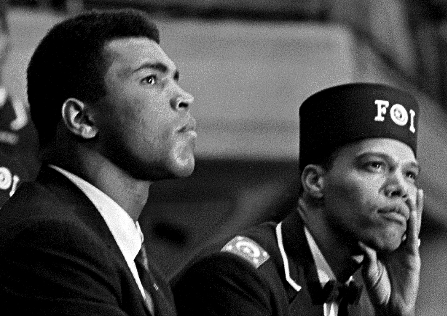 Close-up of American boxer Muhammad Ali (born Cassius Clay) (left) and Nation of Islam leader Louis Farrakhan (born Louis Walcott) as they listen to a speaker during the Saviour's Day celebrations at the International Ampitheatre, Chicago, Illinois, February 27, 1966.