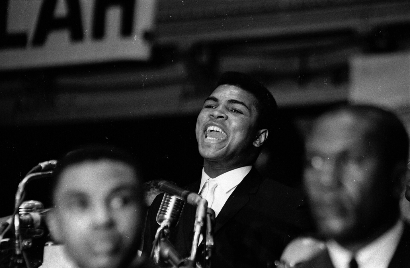 American boxer Muhammad Ali (born Cassius Clay) (left) speaks from a lecturn during the Saviour's Day celebrations at the International Ampitheatre, Chicago, Illinois, February 27, 1965.