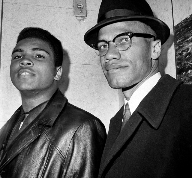 UNITED STATES - MARCH 02: Cassius Marcellus Clay (Muhammad Ali) with Black Muslim leader Malcolm X at 125th St. and Seventh Ave.