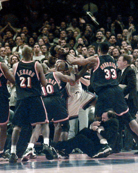 UNITED STATES - APRIL 30: New York Knicks vs. Miami Heat at MSG for Game4... Knicks Charles Oakley is shoved by Heats Alonzo Mourning while Jeff Van Gundy got a piece of Alonzo's leg trying to seperate players. (Photo by Linda Cataffo/NY Daily News Archive via Getty Images)