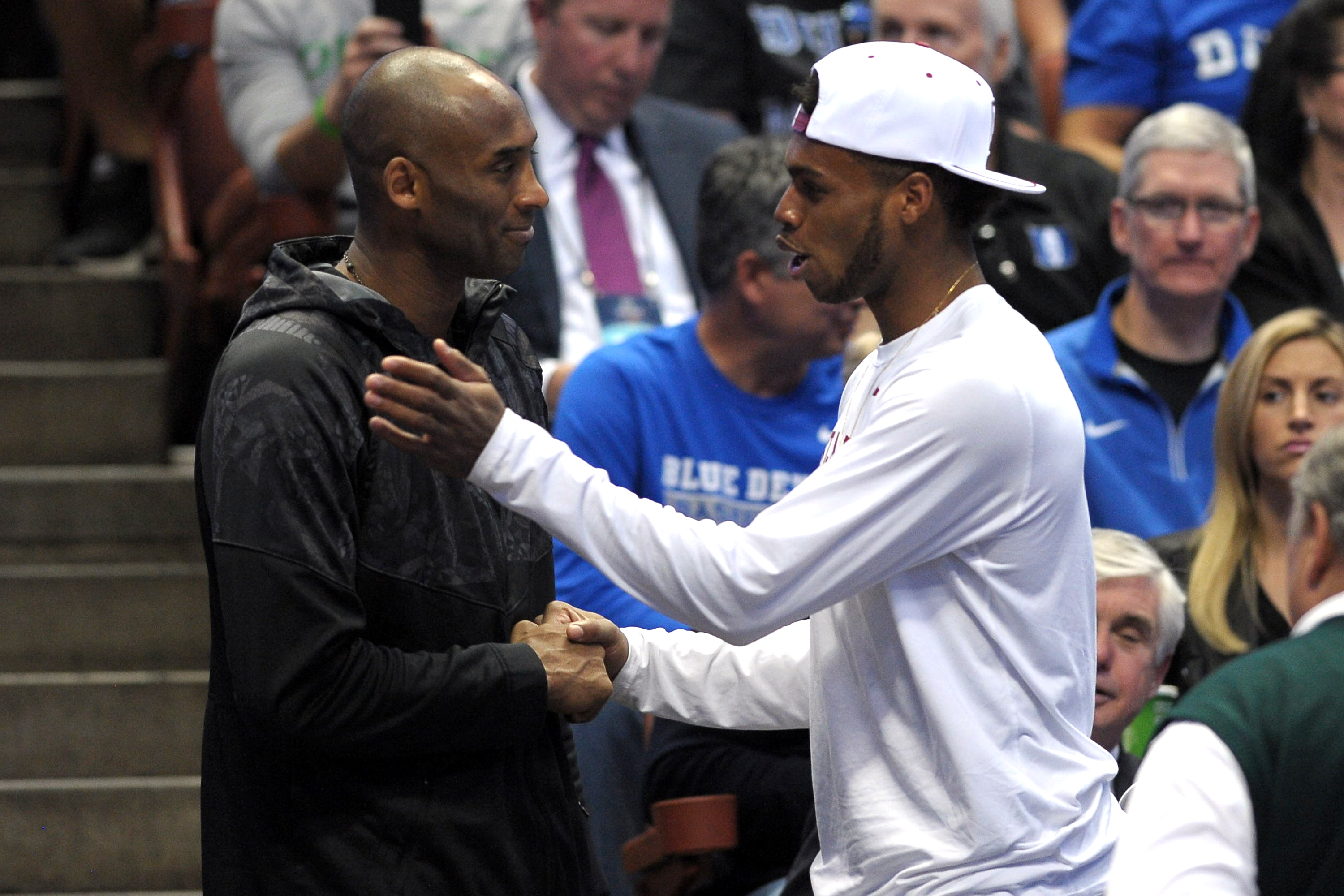 Kobe Bryant of the Los Angeles Lakers (L) talks with Buddy Hield of the Oklahoma Sooners during the game between the Duke Blue Devils and the Oregon Ducks during the West Regional Semifinal of the 2016 NCAA Men's Basketball Tournament at Honda Center on March 24, 2016 in Anaheim, California.