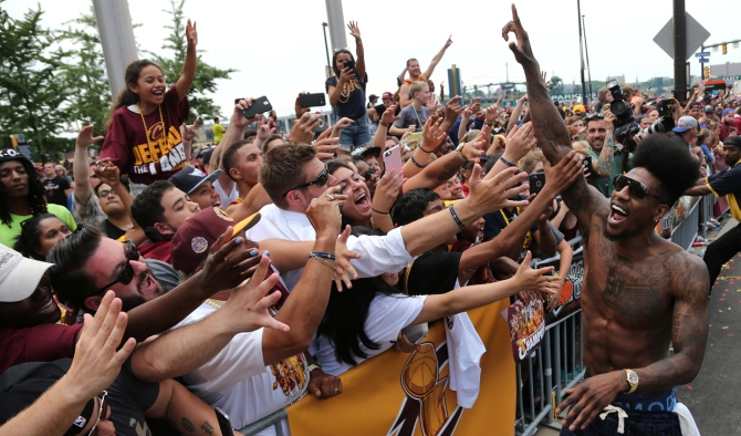 Cleveland Cavaliers Iman Shumpert celebrates with the crowd in downtown Cleveland