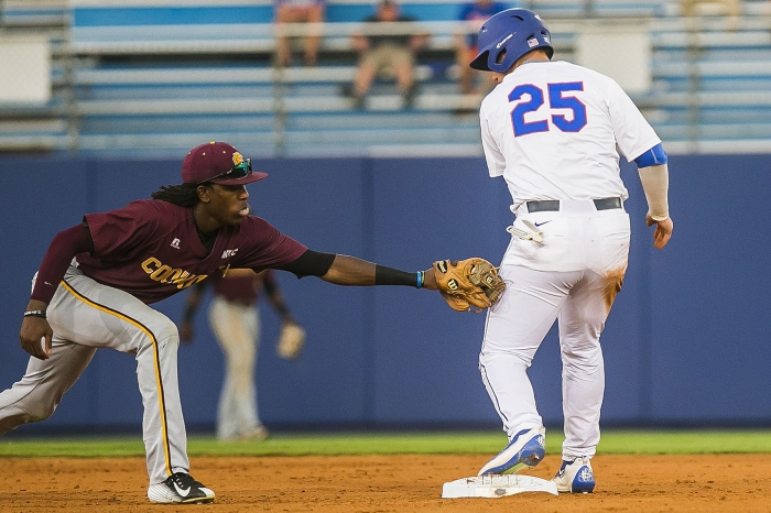 Bethune-Cookman's Demetrius Sims, left, tags Florida's Danny Reyes (25) late at second base in an NCAA college regional baseball game Friday, June 3, 2016, in Gainesville, Fla.