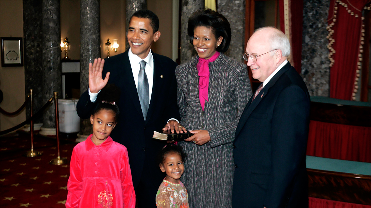 A Jan. 5, 2005 file photo shows Vice President Dick Cheney, right, administering the Senate oath to Sen. Barack Obama, D-Ill., left, during a mock swearing-in on Capitol Hill as his wife Michelle, center, and children, Malia, front left, and Sasha look on.