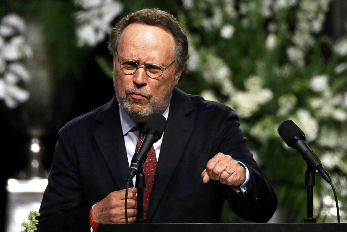 Actor Billy Crystal speaks at a memorial service for the late boxer Muhammad Ali in Louisville, Kentucky, U.S., June 10, 2016.