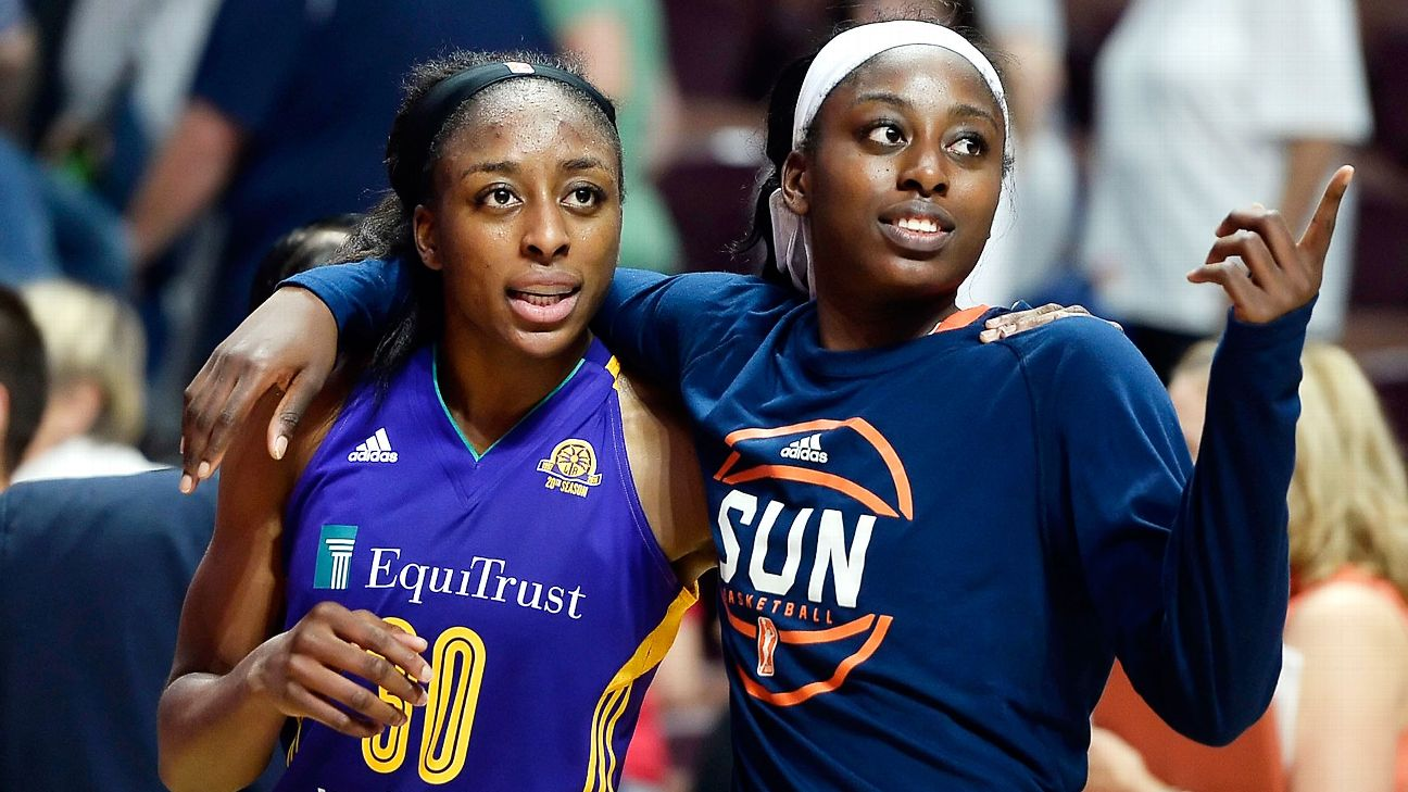 Sisters Los Angeles Sparks' Nneka Ogwumike, left, and Connecticut Sunâs Chiney Ogwumike, right, walk off the court together at the end of a WNBA basketball game between the their teams, Thursday, May 26, 2016, in Uncasville, Conn. (AP Photo/Jessica Hill)
