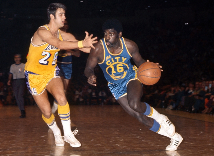 San Francisco Warriors guard Al Attles (16) is defended by Los Angeles Lakers guard Gail Goodrich (25) at the Forum.