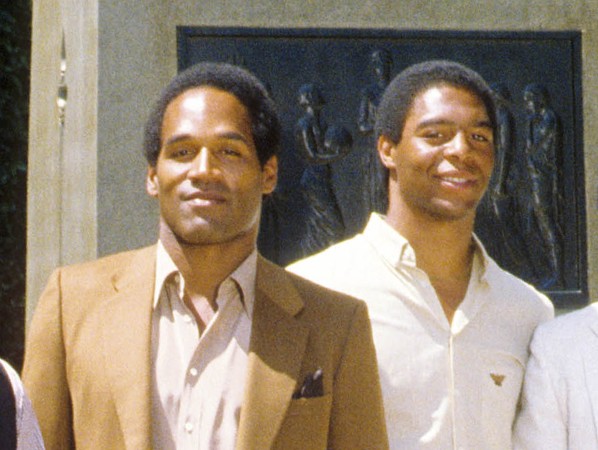 Southern California Trojans former running backs O.J. Simpson and Marcus Allen pose for a photo on campus.