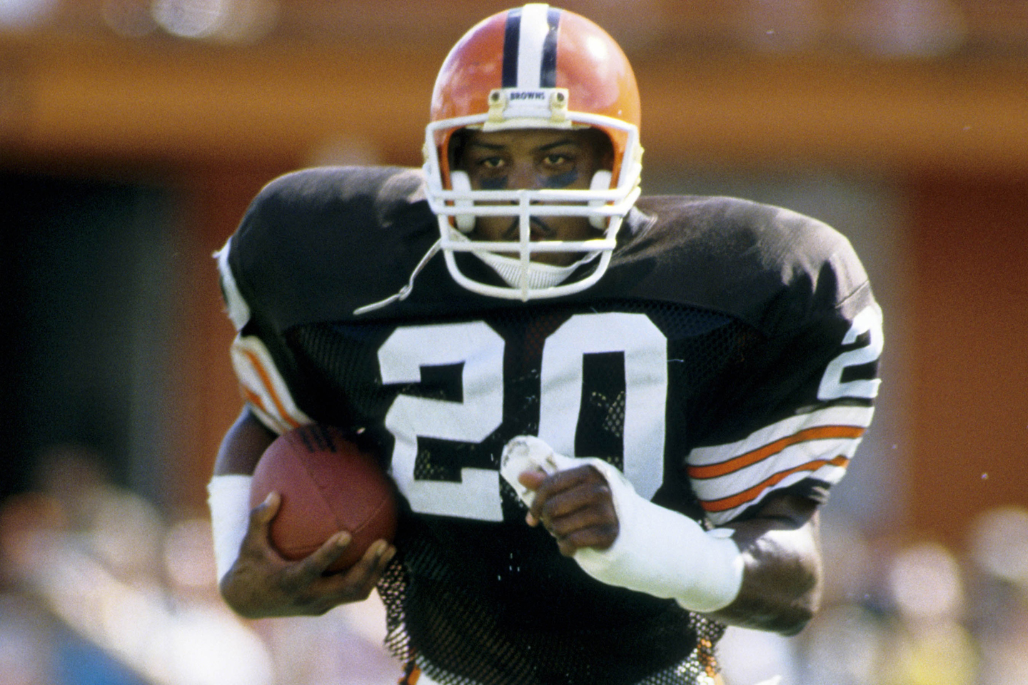 Cleveland Browns defensive back Don Rogers (20) carries the ball against the Miami Dolphins during the 1985 AFC Divisional Playoff Game at the Orange Bowl.