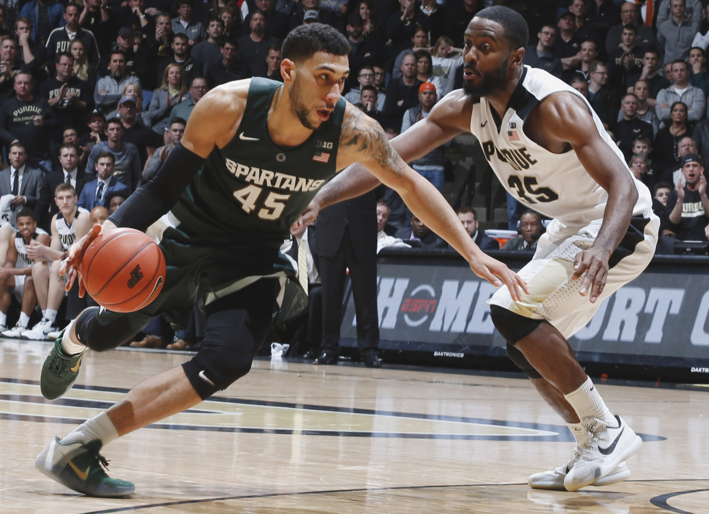 Michigan State Spartans guard Denzel Valentine (45) drives to the basket against Purdue Boilermakers guard Rapheal Davis (35) at Mackey Arena. Purdue defeats Michigan State 82-81 in overtime.