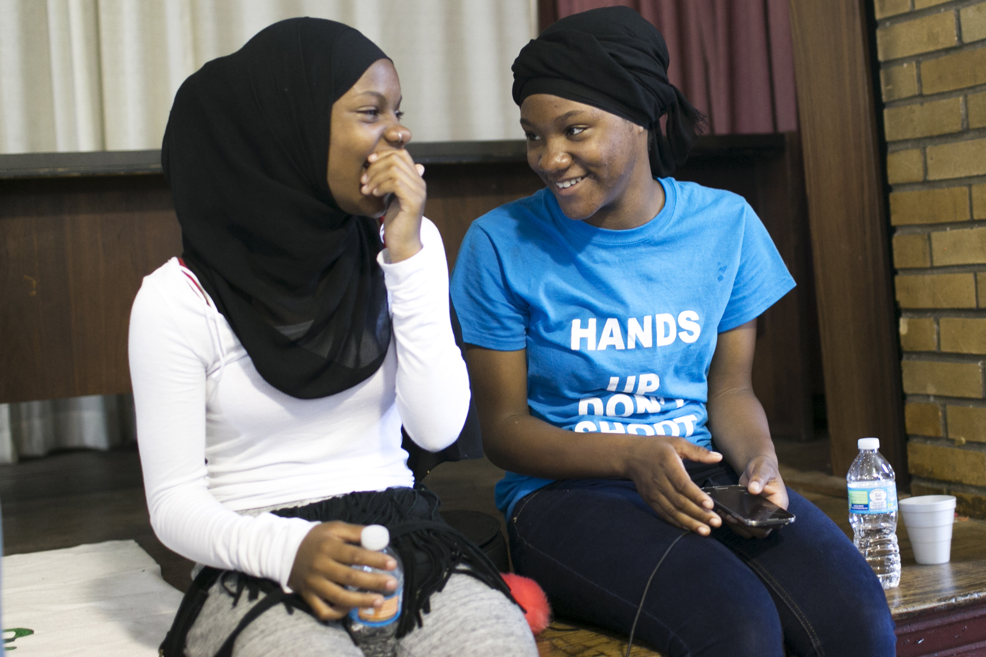Attalah Abdulhaqq, Tacharah Abdulhaqq, Taharah Abdulhaqq, and Faith Green hang out after a peace camp at a Masonic Hall in Cleveland, OH on Tuesday, July 19, 2016.