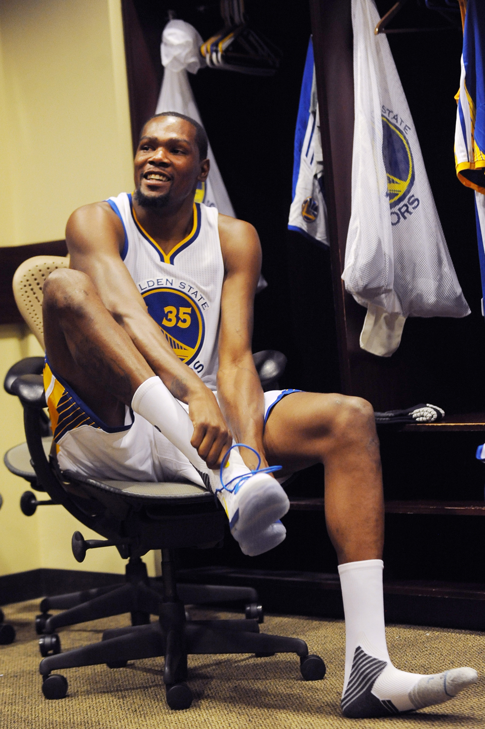 OAKLAND, CA - JULY 7: Kevin Durant #35 of the Golden State Warriors prepares in the locker room before his introductory press conference on July 7, 2016 in Oakland, California.
