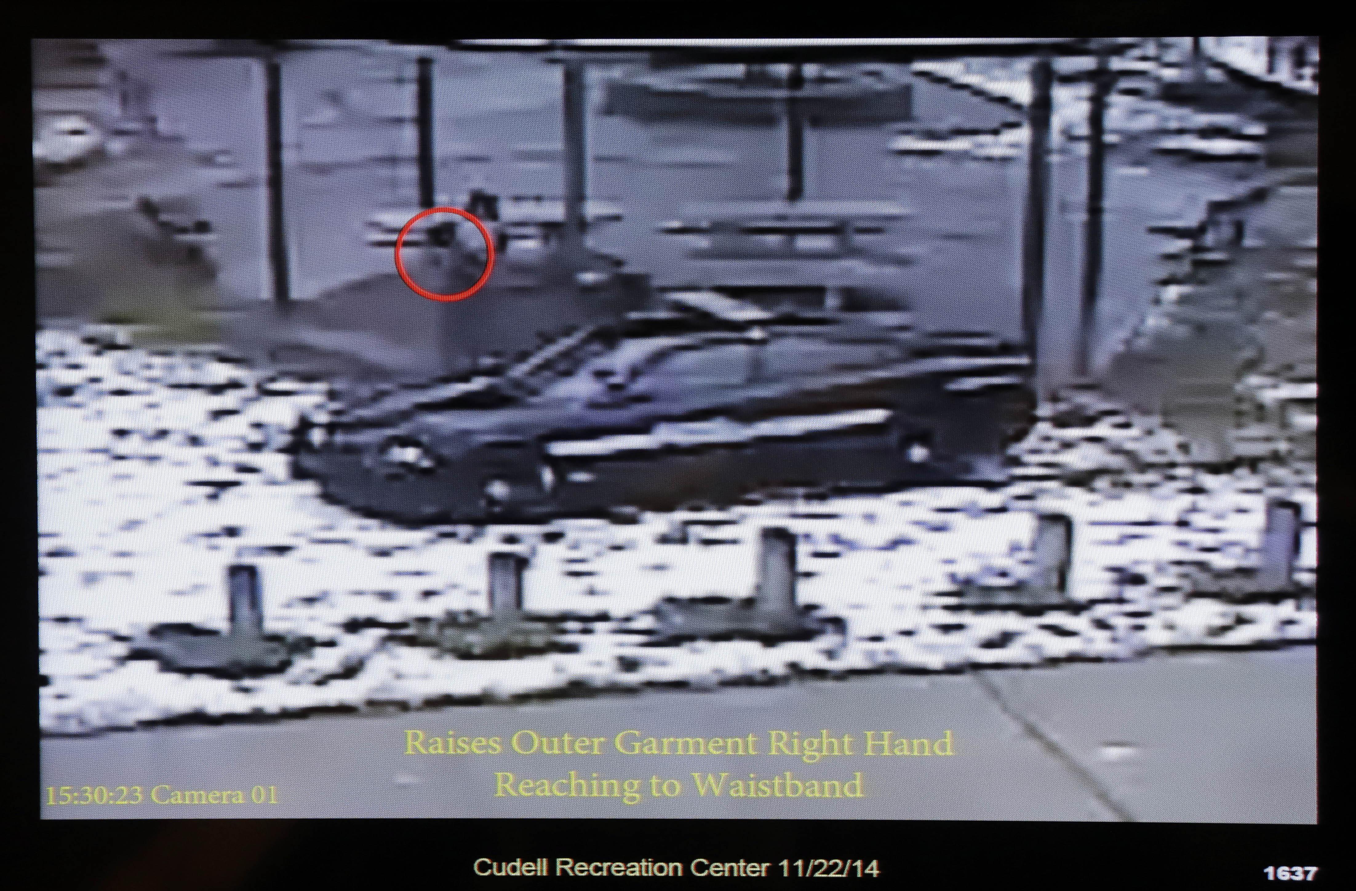 This still image taken from a surveillance video played at a news conference held by Cleveland Police, Wednesday, Nov. 26, 2014, shows Cleveland police officers arriving at Cudell Park on a report of a man with a gun. Twelve-year-old Tamir Rice was fatally shot by a Cleveland police officer Saturday, Nov. 22, 2014, after he reportedly pulled a replica gun at the city park.