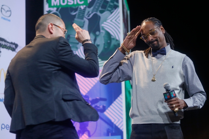 "Snoop Dogg, right, greets his manager Ted Chung at the beginning of the ""Keynote Conversation with Snoop Dogg"" during the SXSW Music Festival on Friday, March 20, 2015 in Austin, Texas."