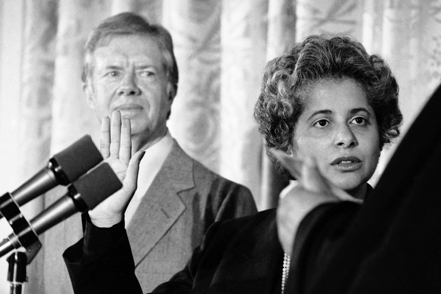 U.S. President Jimmy Carter watches as Patricia Roberts Harris is sworn in Washington, Friday, August 3, 1979 as Secretary of Health, Education Welfare.