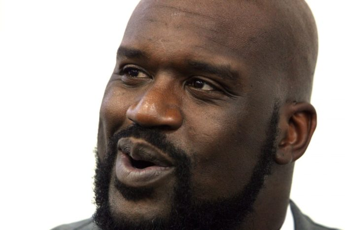 Shaquille O'Neal laughs at a member of the media during interviews after he officially announced his retirement from his home in Windermere, Florida, Friday, June 3, 2011.