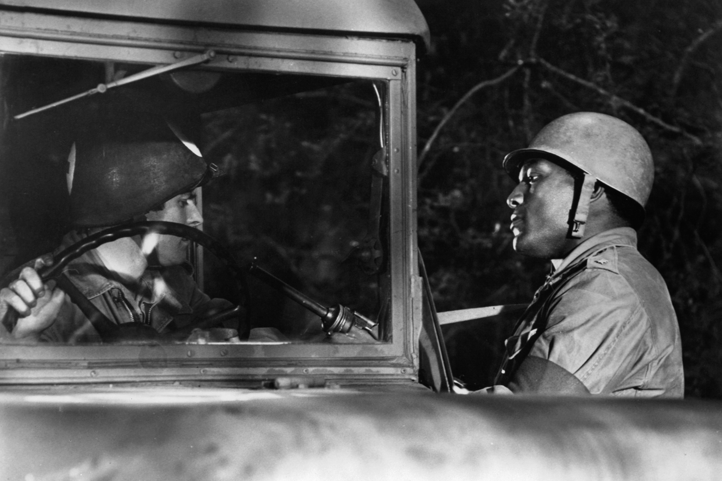 Jim Brown holds up an ambulance driver in a scene from the film 'The Dirty Dozen', 1967.