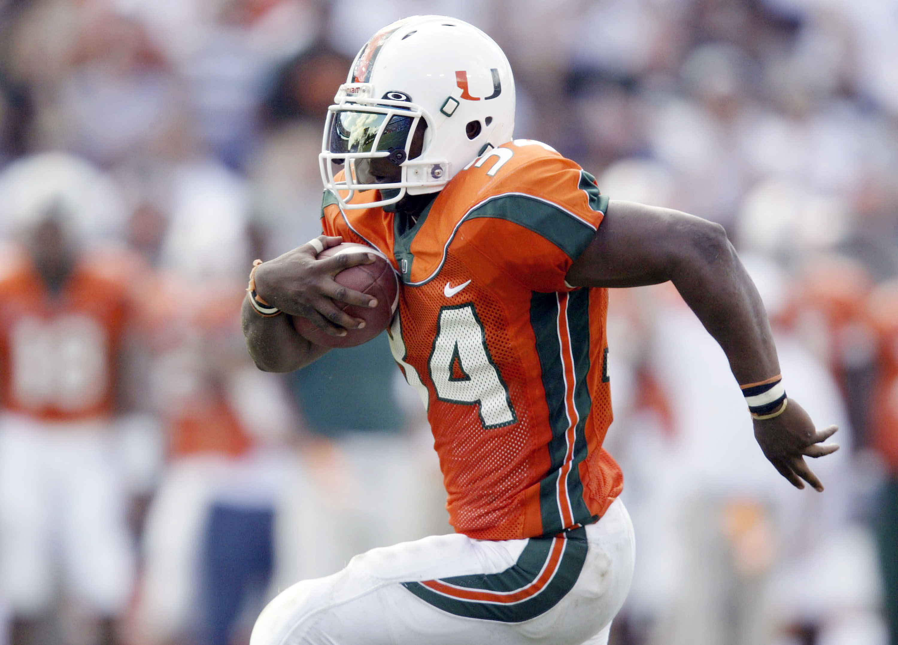Jarrett Payton #34 of Miami carries the ball against Rutgers November 22, 2003 at the Orange Bowl in Miami, Florida.