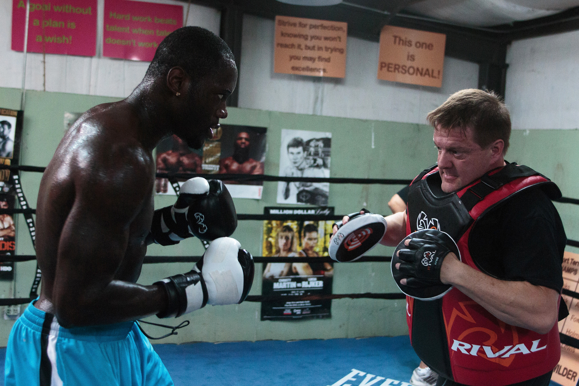 WBC Heavyweight Champion Deontay Wilder works with trainer Jay Deas during his media workout on May 28, 2015 in Northport, Alabama.