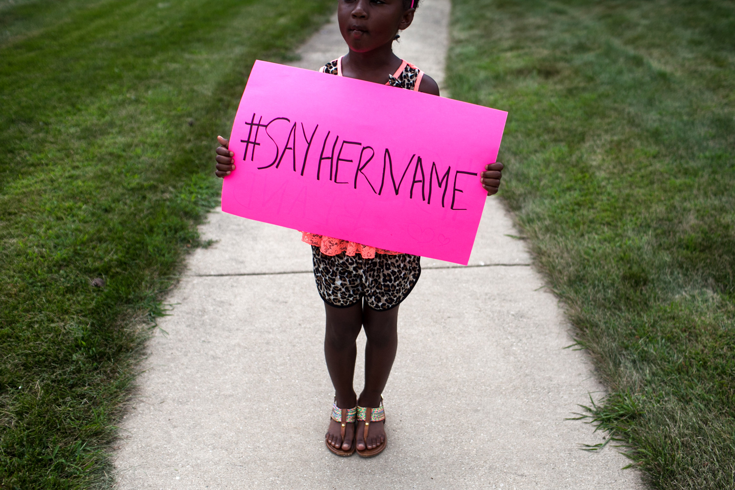 Daija Belcher, 5, holds a sign in front of the DuPage African Methodist Episcopal Church during the funeral service for Sandra Bland on July 25, 2015 in Lisle, Illinois. Bland's death roused suspicion nationwide after the 28-year-old was found hanging from a plastic bag three days after she was pulled over by a Texas State Trooper for a traffic violation.
