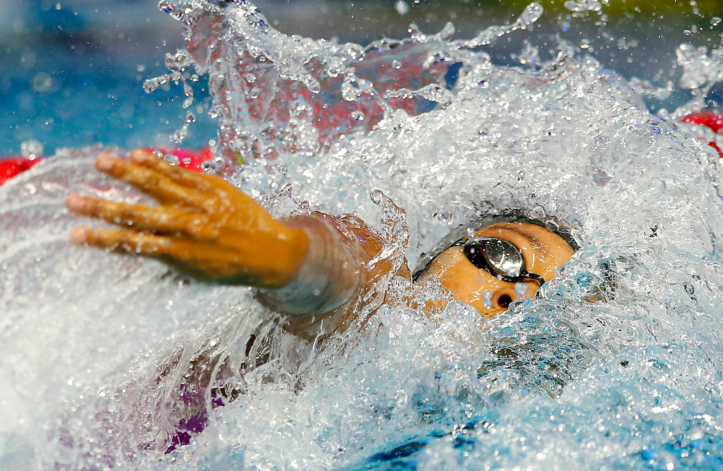 Lia Neal competes in the Women's 4x100m Freestyle during day two of the Mutual of Omaha Duel in the Pool at Indiana University Natatorium on December 12, 2015 in Indianapolis, Indiana.