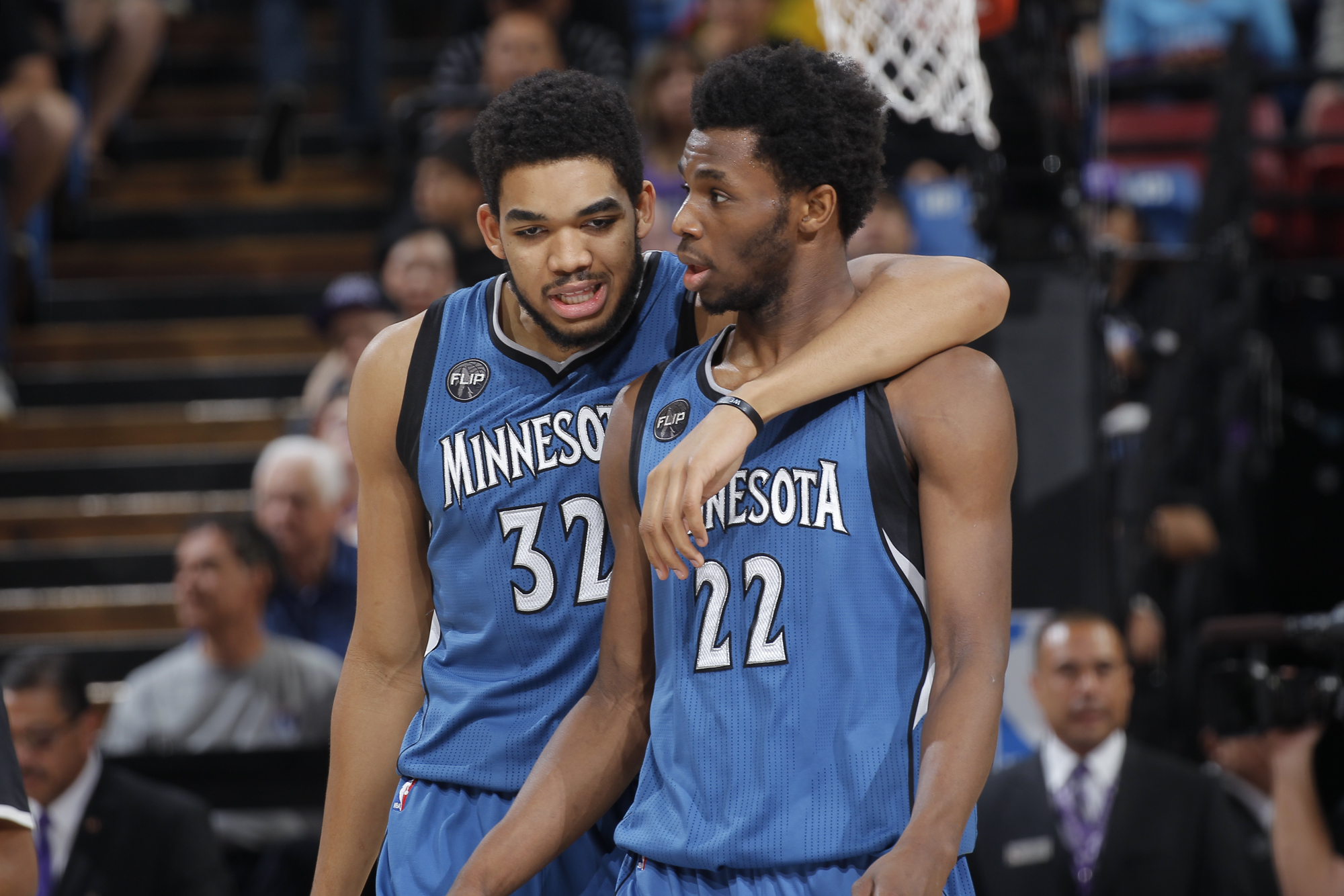 Karl-Anthony Towns #32 of the Minnesota Timberwolves and Andrew Wiggins #22 of the Minnesota Timberwolves walk off the court against the Sacramento Kings at Sleep Train Arena on April 7, 2015 in Sacramento, California.