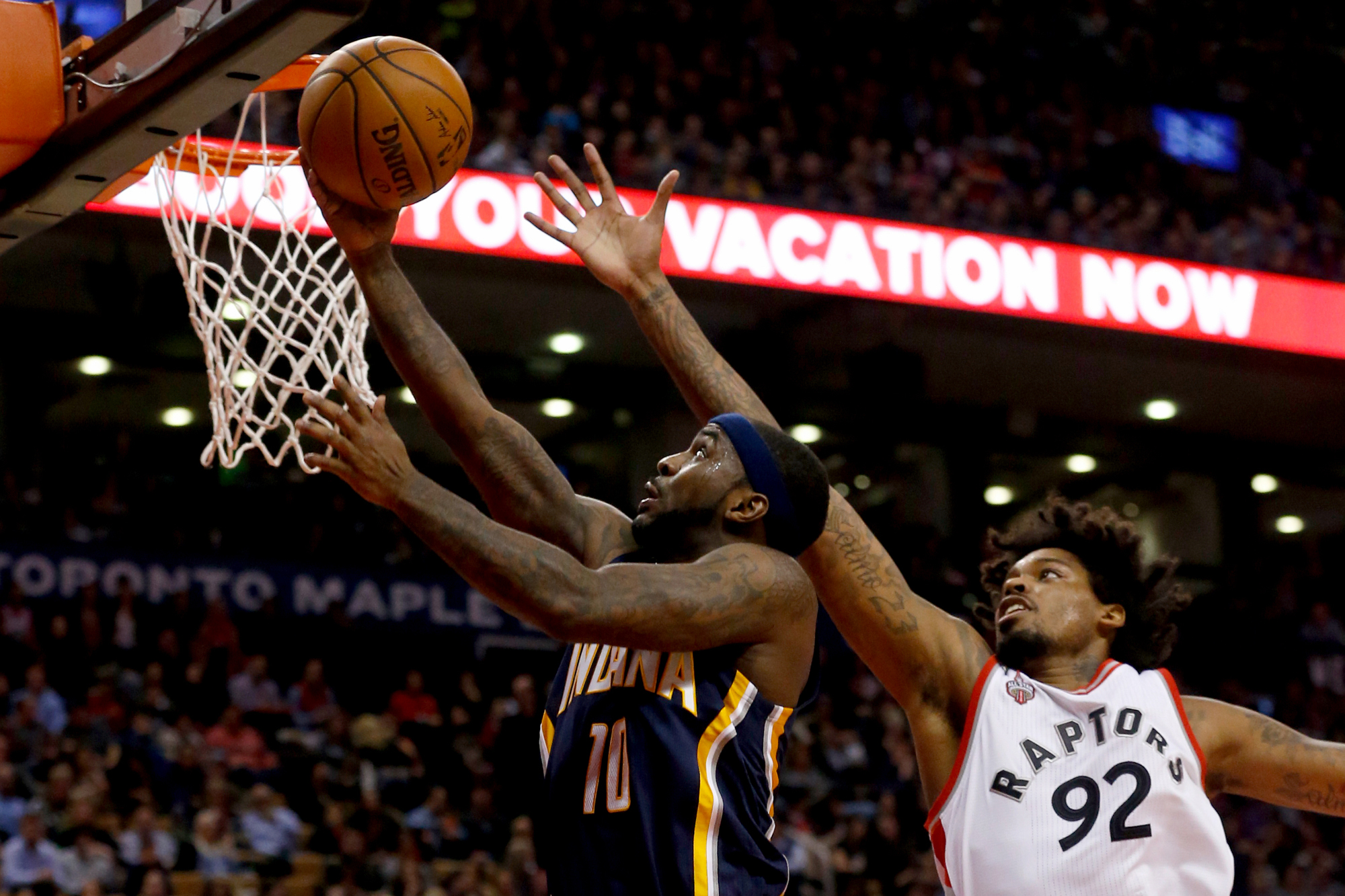 Indiana Pacers guard Ty Lawson (10) beats Toronto Raptors center Lucas Nogueira (92) for a lay up. Toronto Raptors vs Indiana Pacers in 2nd half action of NBA regular season play at Air Canada Centre.