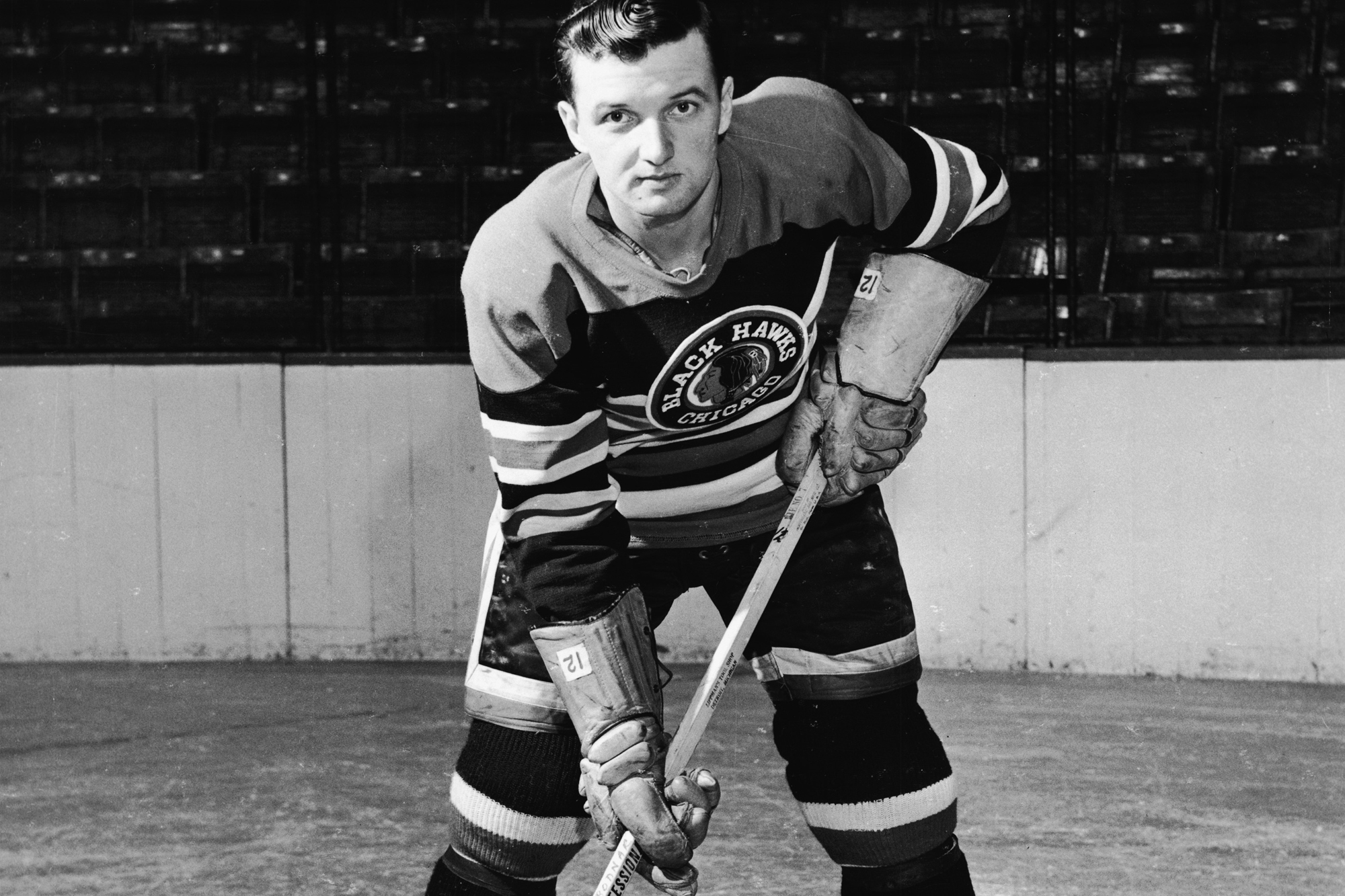 Canadian professional hockey player center Gus Bodnar (1923 - 2005) of the Chicago Blackhawks poses for a portrait on the ice, mid 20th Century. Bodnar played with the Blackhawks from 1947 to 1954.