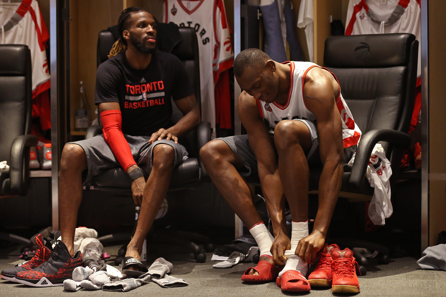 DeMarre Carroll #5 and Bismack Biyombo #8 of the Toronto Raptors get ready before Game Six of the NBA Eastern Conference Finals against the Cleveland Cavaliers at Air Canada Centre on May 27, 2016 in Toronto, Ontario, Canada.