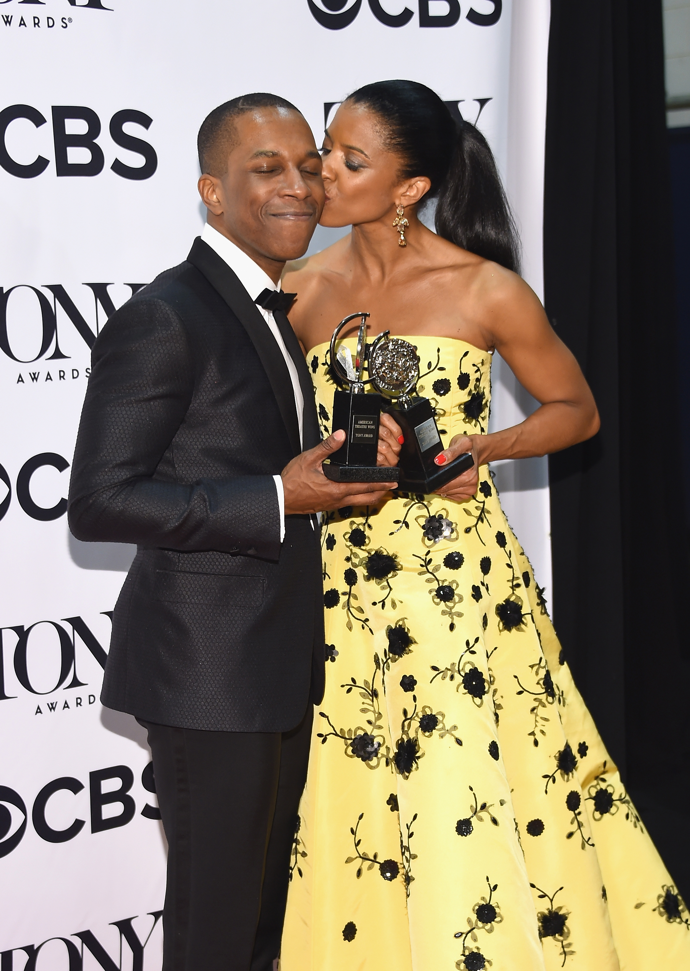 Hamilton's Leslie Odom Jr. gets a kiss from co-star Renee Elise Goldsberry after they both won Tonys in June.