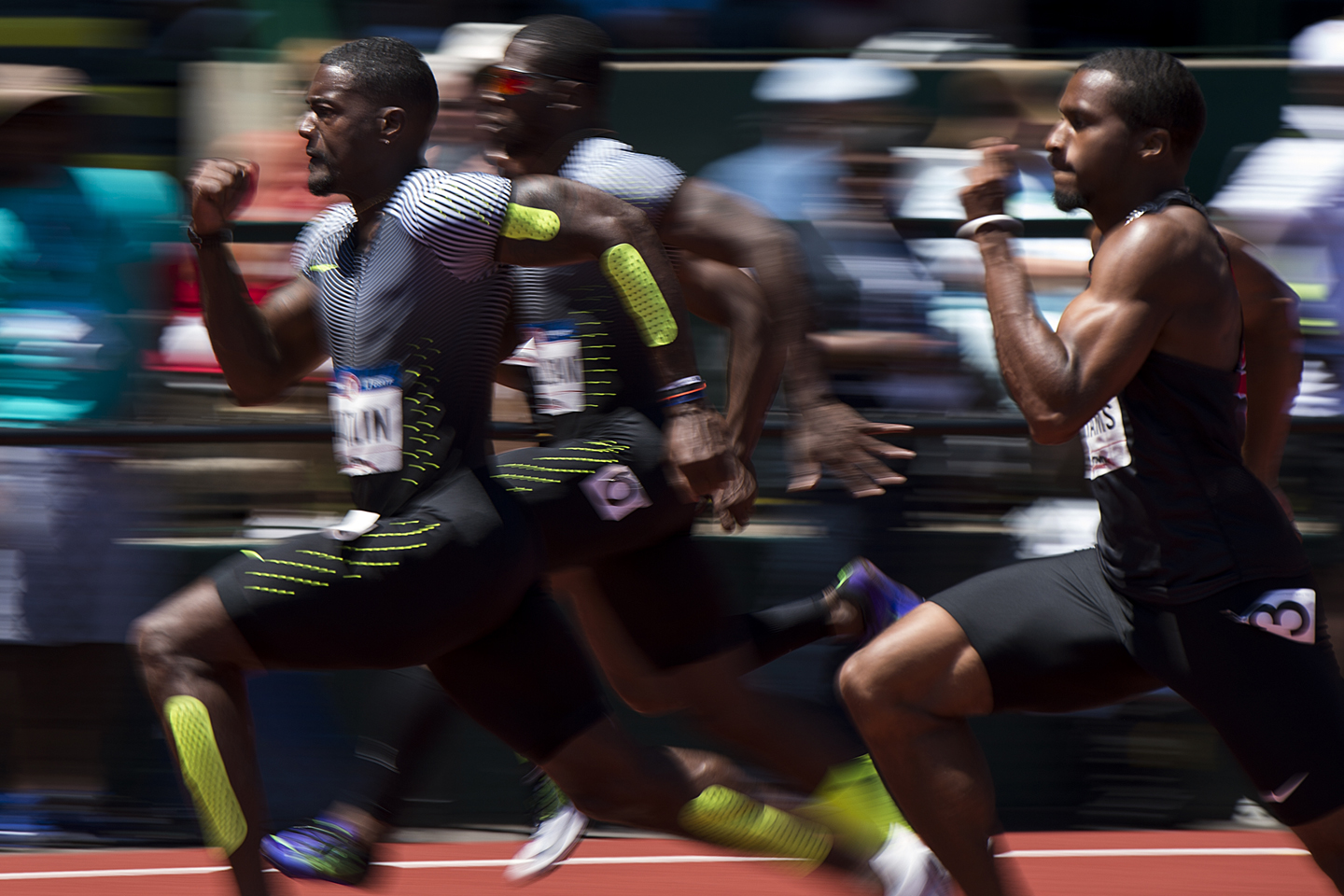 Justin Gatlin (L) leads his heat of the 100 meters during the first round on Day 2 of the Olympic Track and Field Trials at Hayward Field on July 2, 2016, in Eugene, Oregon.