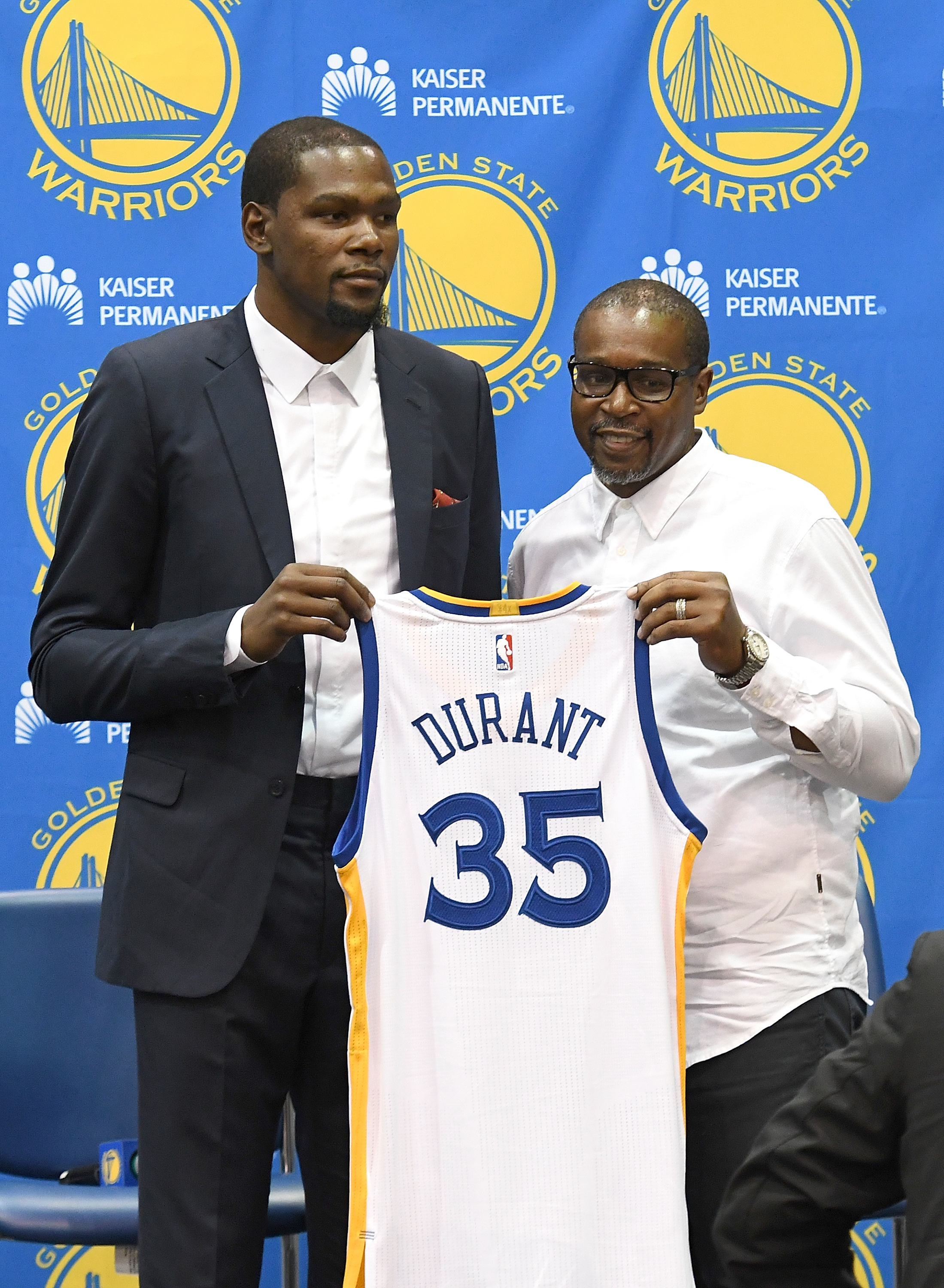 OAKLAND, CA - JULY 07: Kevin Durant #35 of the Golden State Warriors stands with his father Wayne Pratt during the press conference where Durant was introduced as a member of the Golden State Warriors.