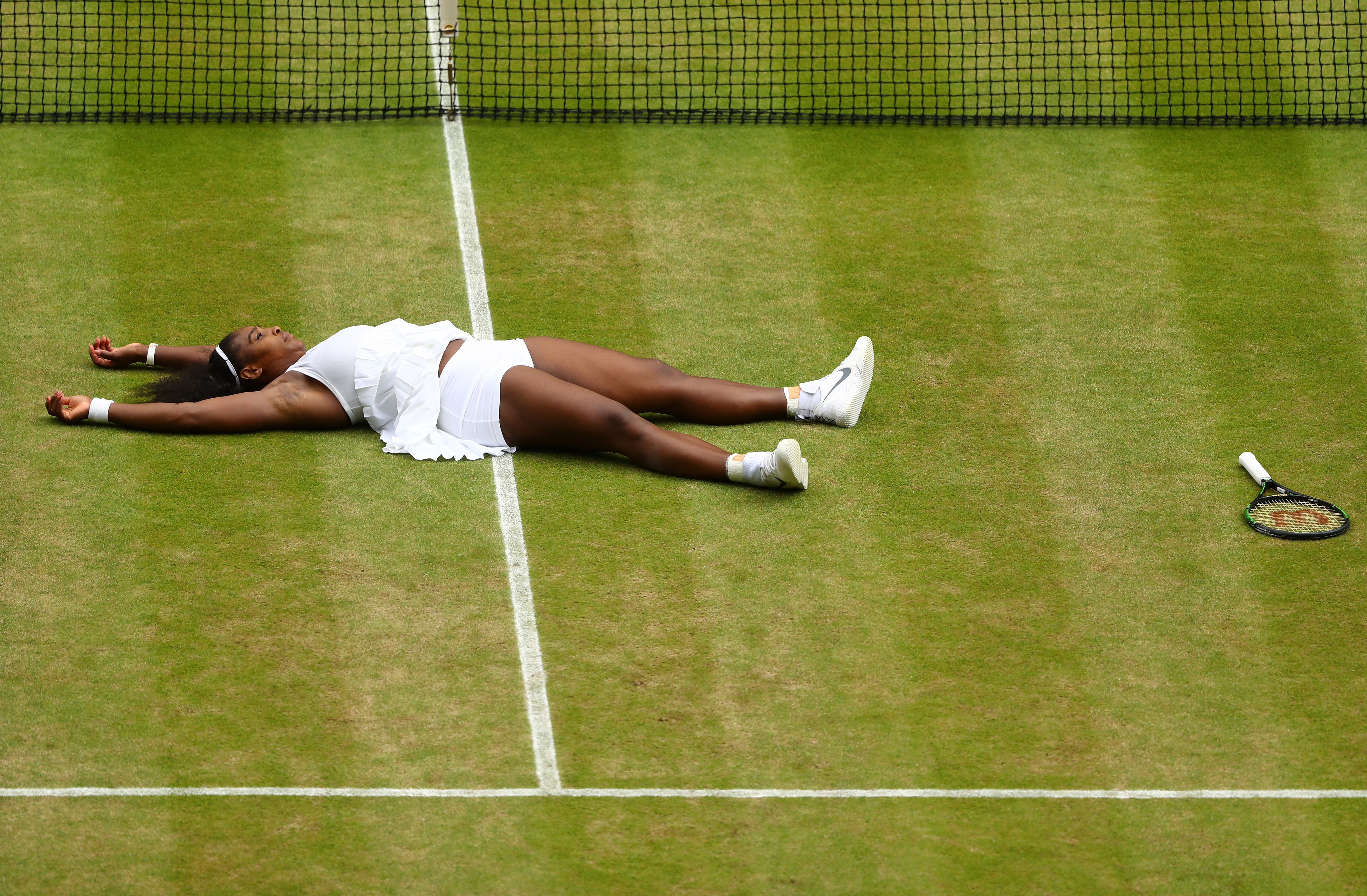 LONDON, ENGLAND - JULY 09: Serena Williams of The United States celebrates victory following The Ladies Singles Final against Angelique Kerber of Germany.