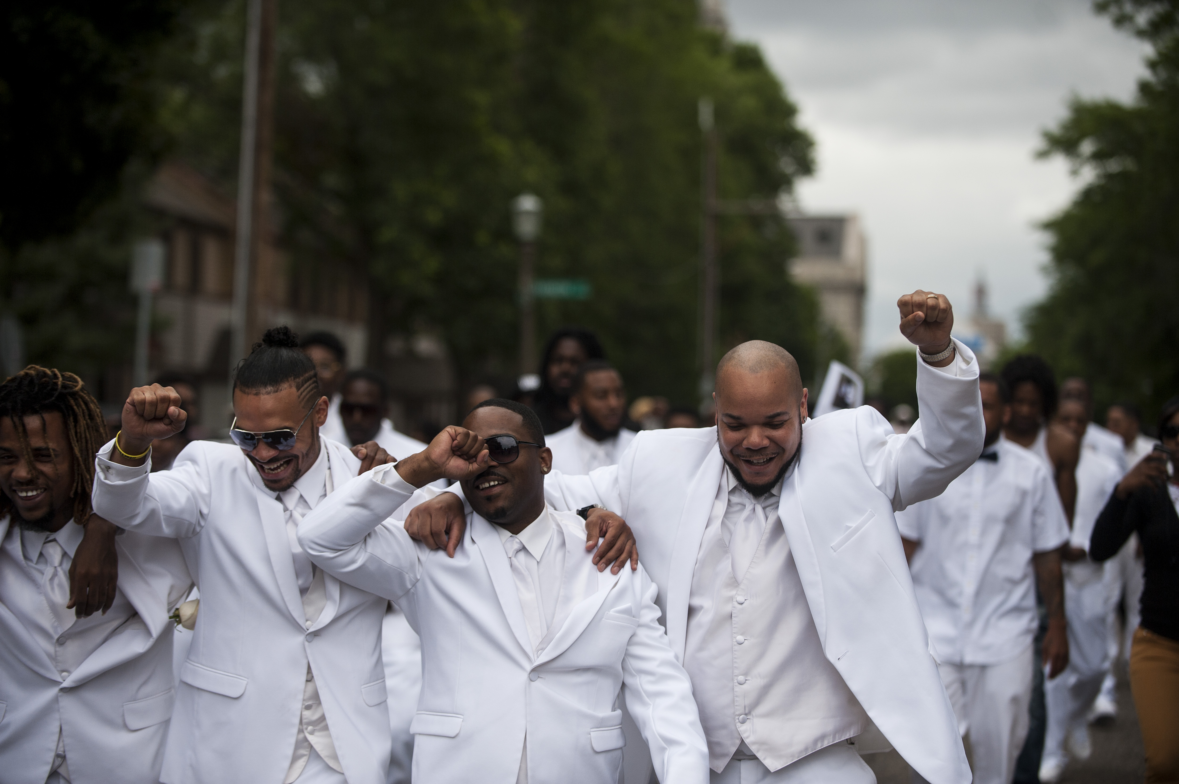 Pallbearers lead a march down Selby Avenue after the funeral of Philando Castile at the Cathedral of St. Paul on July 14, 2016 in St. Paul, Minnesota. Castile was shot and killed on July 6, 2016 by police in Falcon Heights, Minnesota.