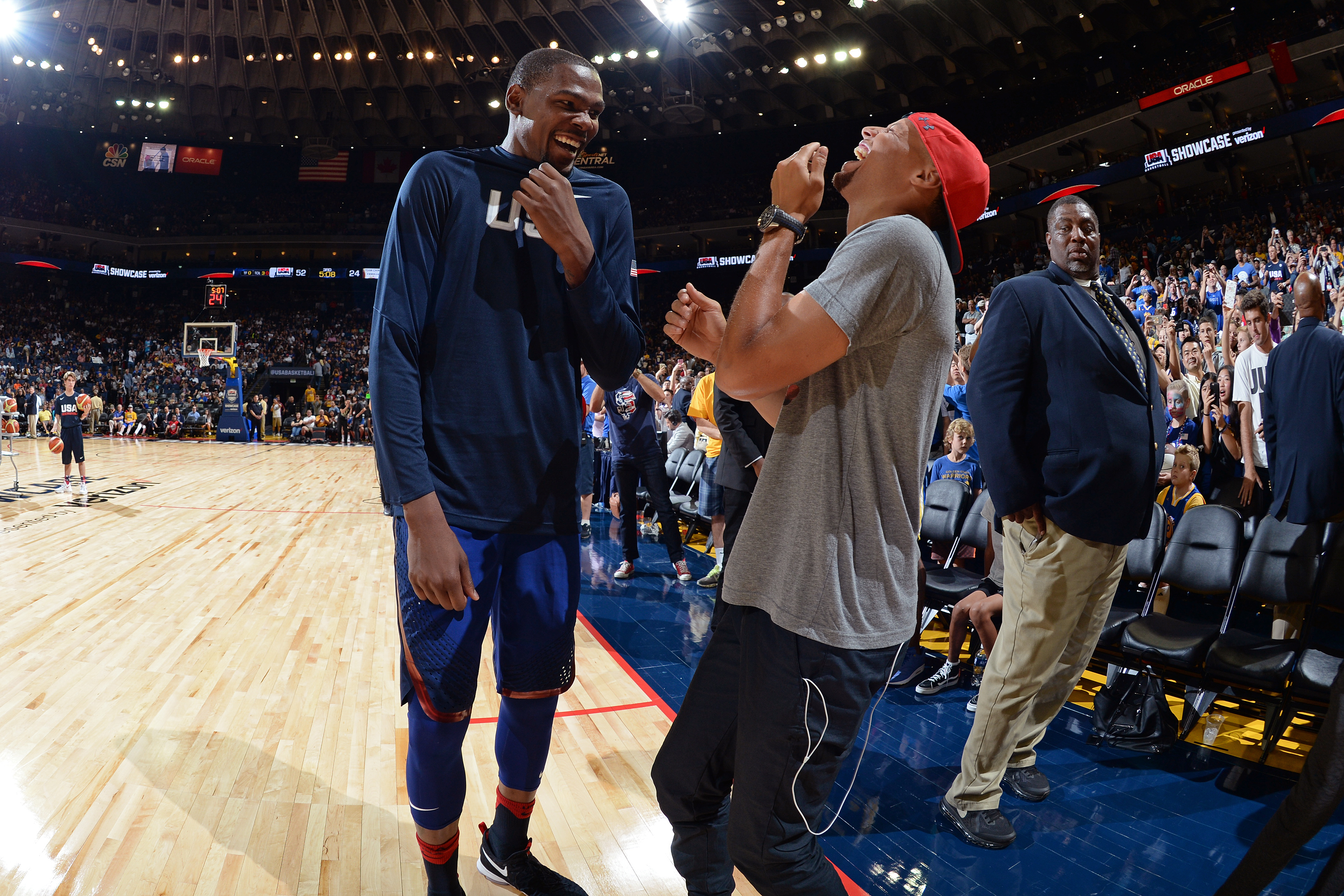 OAKLAND, CA - JULY 26: Kevin Durant #5 of the USA Basketball Men's National Team speaks with Stephen Curry #30 of the Golden State Warriors during the game against China on July 26, 2016 at ORACLE Arena in Oakland, California.