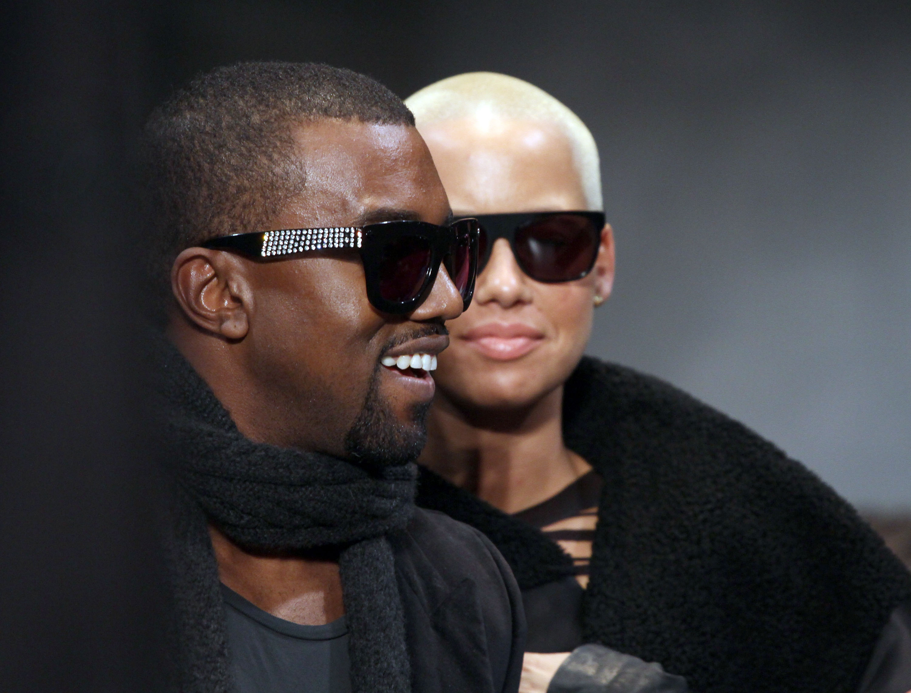 Kanye West and Amber Rose attend the Cerruti fashion show during Paris Menswear Fashion Week Autumn/Winter 2010 at Palais de Tokyo on January 22, 2010 in Paris, France.