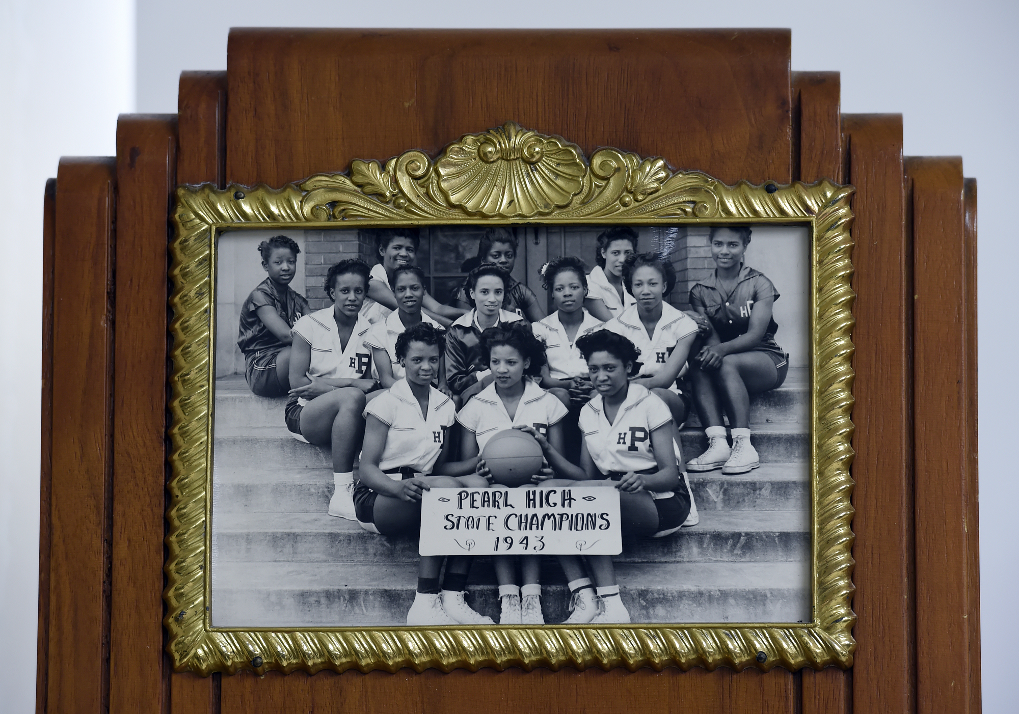 A photograph of Pearl High School's women's basketball team from 1943 on display in a room that was once one of the school's original locker rooms on Monday, July 11, 2016, in Nashville, Tenn.