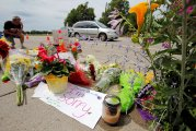 Man kneels at shooting site of Philando Castile in Minnesota